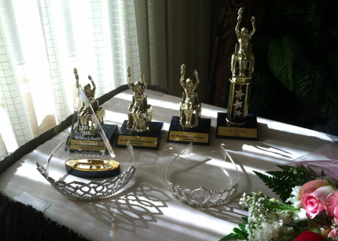 ms wheelchair crowns on table and trophies